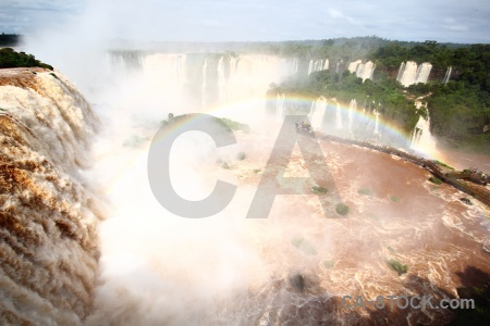 Iguazu falls waterfall rainbow brazil spray.
