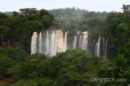 Iguazu river water spray sky iguassu falls.