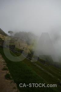 Inca terrace unesco fog sky.