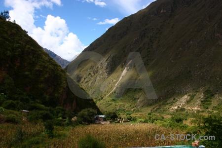 Inca trail grass sky huayllabamba building.