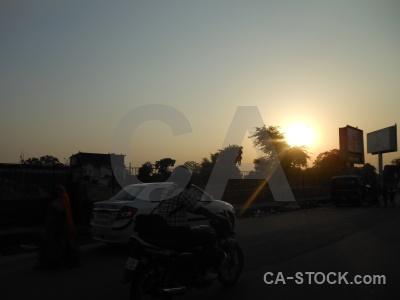 Jaipur india moped tree sunrise.