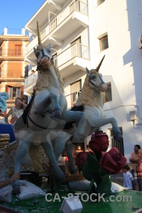 Javea float building person horse.