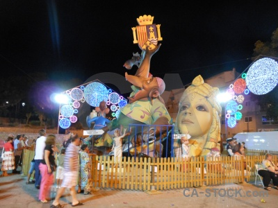 Javea statue fiesta yellow person.