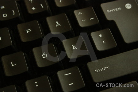 Key black object computer keyboard.