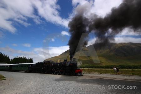 Kingston flyer railway cloud mountain person.