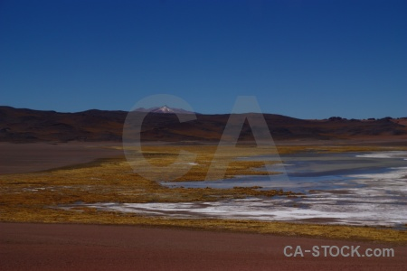 Lake altitude salt flat landscape water.