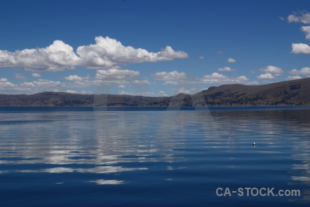 Lake titicaca peru reflection mountain sky.
