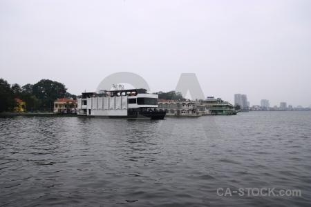 Lake vehicle boat building sky.
