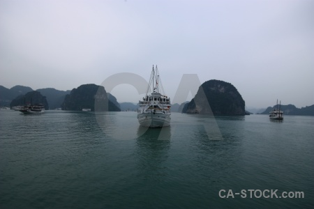 Limestone sky boat southeast asia ha long bay.