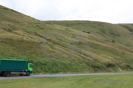 Lorry landscape white field green.