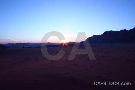 Middle east sunset sun sky rock.