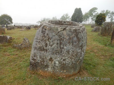 Misty plain of jars grass rock phonsavan.