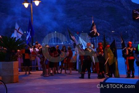 Moors smoke flag person fiesta.