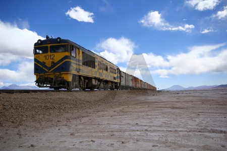 Mountain cloud train track salar de chiguana south america.