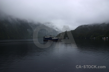 Mountain fiord fiordland doubtful sound boat.