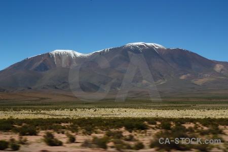 Mountain grass snow altitude argentina.