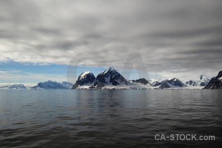Mountain sea water antarctica landscape.
