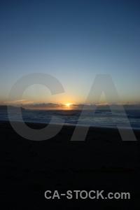 New zealand sea sky sunrise water.