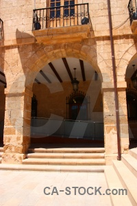 Orange brown building archway denia.