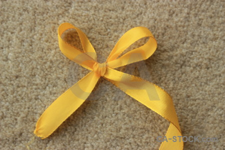 Orange brown ribbon yellow object.