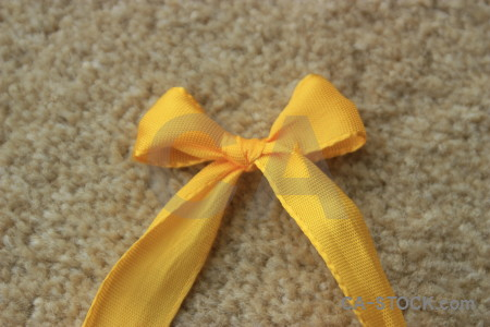 Orange object ribbon brown yellow.