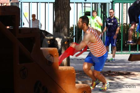 Orange person bull javea spain.