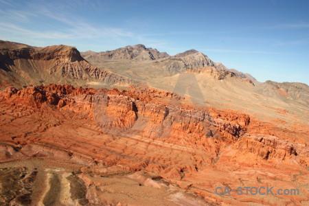 Orange rock blue mountain desert.