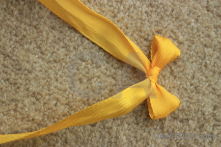 Orange yellow brown ribbon object.