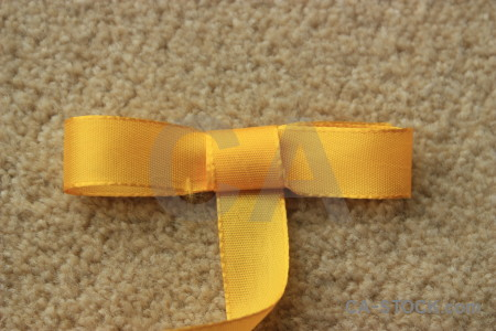 Orange yellow object brown ribbon.