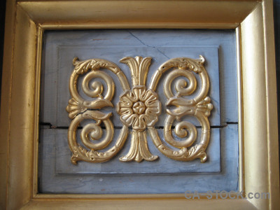 Ornate brown frame.