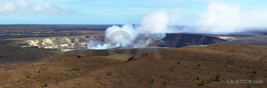 Panoramic smoke volcanic crater landscape.