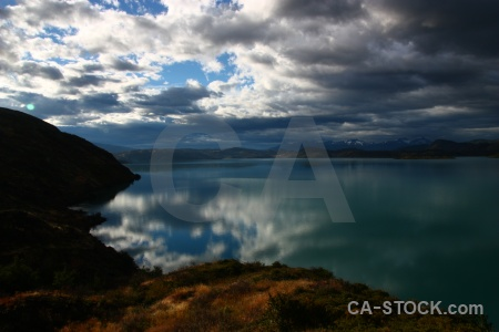 Patagonia landscape torres del paine water grass.