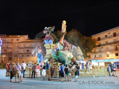 Person building fiesta javea statue.