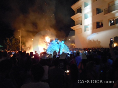 Person building javea fiesta fire.