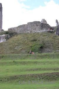 Person castle white building green.