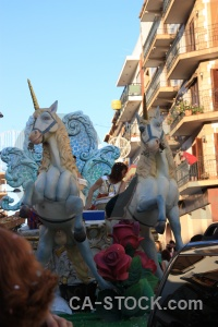 Person fiesta javea building float.