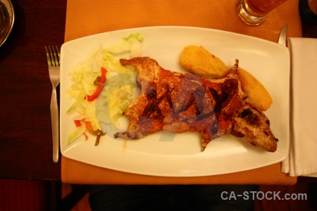 Peru cuy guinea pig plate fork.