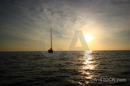 Phi phi island boat sunrise sea southeast asia.