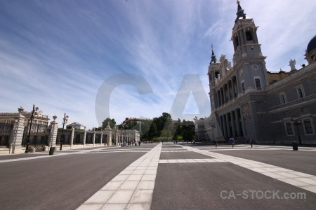 Plaza person madrid almudena cathedral sky.
