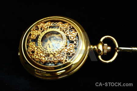 Pocket watch yellow object black.