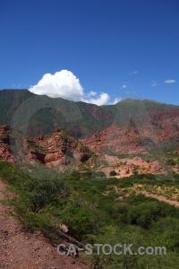 Quebrada de cafayate bush landscape mountain sky.