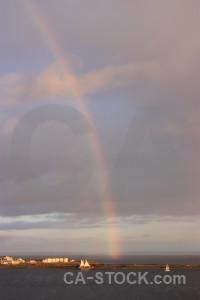 Rainbow cloud gray sky.