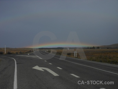 Rainbow sky south island cloud road.