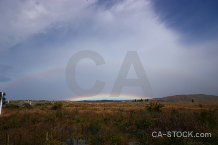 Rainbow south island new zealand field grass.