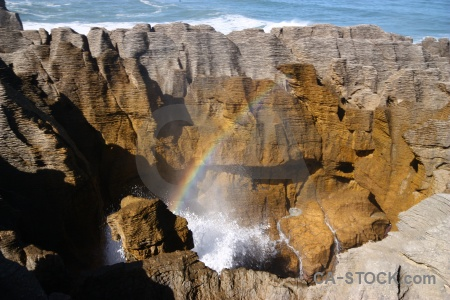 Rainbow south island pancake rocks blowhole sea.