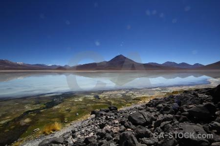 Rock altitude plant landscape sky.