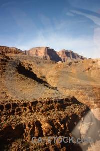 Rock brown blue orange landscape.