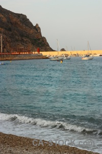 Rock sea javea vehicle boat.
