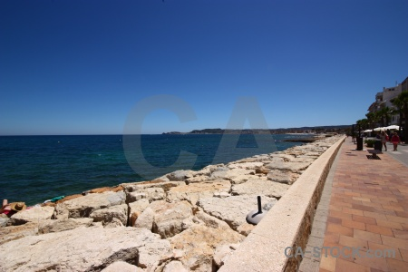 Rock spain sky beach water.