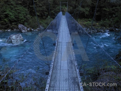 Rock water wire new zealand suspension bridge.